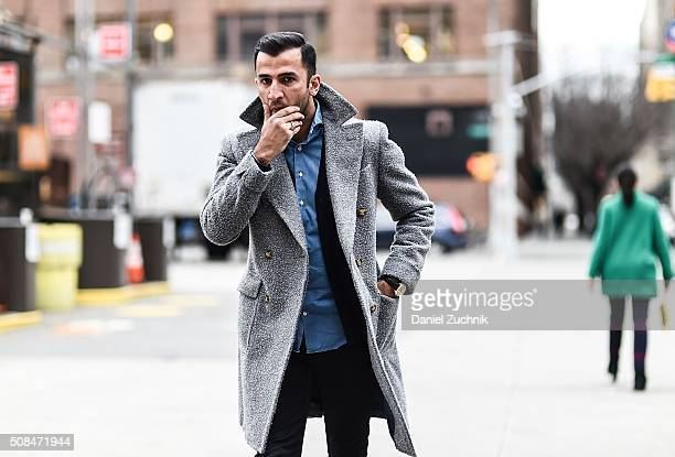 Atif Kazmi is seen outside the Timo Weiland show wearing Suitsupply shirt coat and cardigan Cos jeans and a vintage Omega watch during New York...