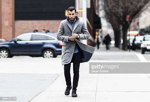 Atif Kazmi is seen outside the Timo Weiland show wearing Suitsupply shirt coat and cardigan Cos jeans Y3 shoes and a vintage Omega watch during New...