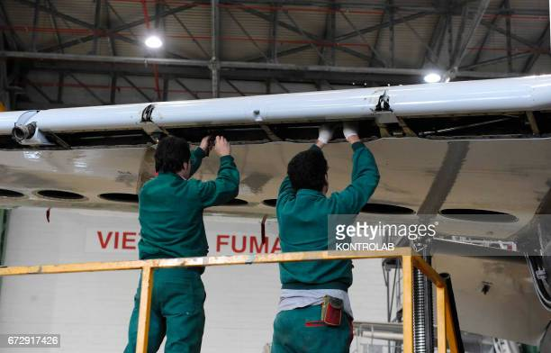 CAPODICHINO NAPLES CAMPANIA ITALY Atitech workers work at a wing of one Alitalia airplane in Atitech Factory in the airport of Capodichino in Naples