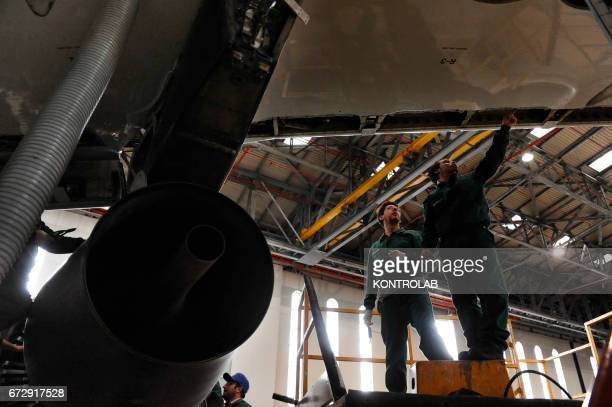 CAPODICHINO NAPLES CAMPANIA ITALY Atitech workers work on Alitalia airplane in Atitech Factory in the airport of Capodichino in Naples