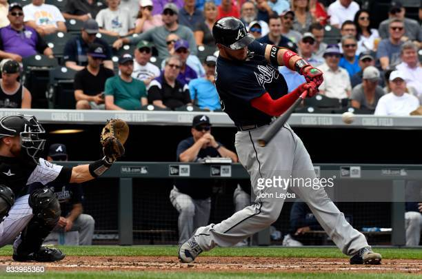 Atlanta Braves catcher Tyler Flowers hits a home run to right center in second inning off of Colorado Rockies starting pitcher Jeff Hoffman on August...