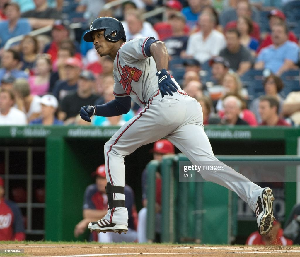 Atlanta Braves center fielder B.J. Upton (2) heads up the first base line after hitting a double off Washington Nationals starting pitcher Jordan Zimmermann (27) during the second inning at Nationals Park in Washington, D.C, Wednesday, August 7, 2013.