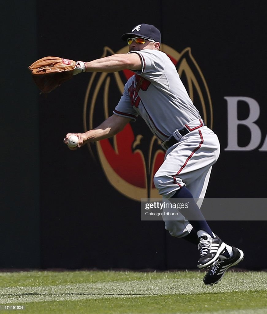 Atlanta Braves center fielder Reed Johnson (7) prepares to throw a ball hit by Chicago White Sox center fielder Alejandro De Aza (30) in the third inning at U.S. Cellular Field in Chicago, Illinois, Sunday, July 21, 2013.
