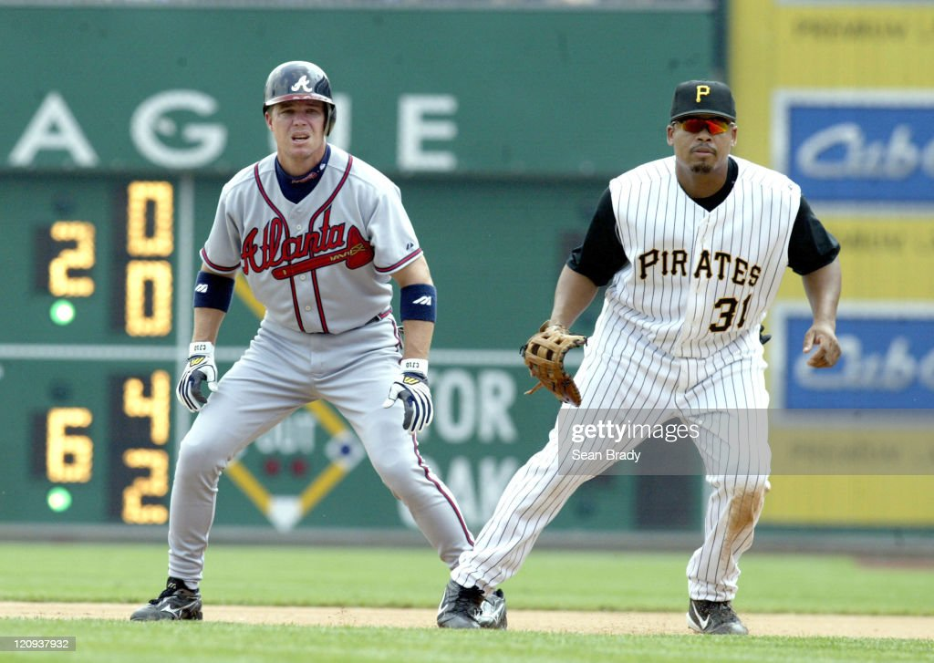 Atlanta Braves Chipper Jones leads off first base as Pittsburgh Pirates Daryl Ward waits for the pitch on June 5, 2005 at PNC Park in Pittsburgh, Pennsylvania.