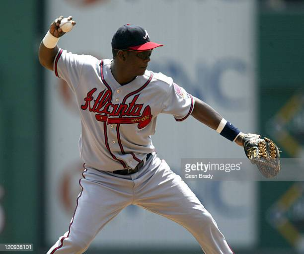 Atlanta Braves Edgar Renteria throws to first for an out against Pittsburgh during action at PNC Park in Pittsburgh Pennsylvania on August 3 2006