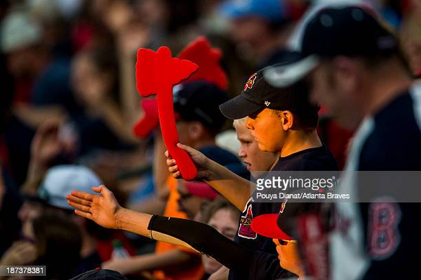 Atlanta Braves fans do the tomahawk chop against the Colorado Rockies at Turner Field on July 29 2013 in Atlanta Georgia The Braves won 98