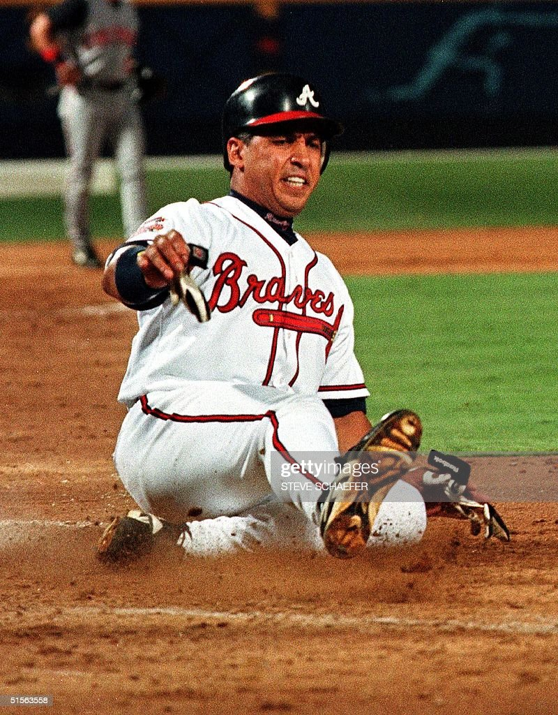 Atlanta Braves First Baseman Andres Galarraga Slides In Safe At Home Off A 3rd Inning Javy