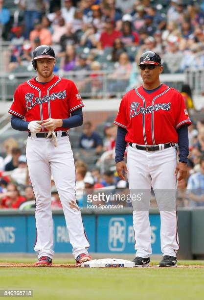 Atlanta Braves first baseman Freddie Freeman with coach Eddie Perez during the major league baseball game between the Atlanta Braves and the Miami...