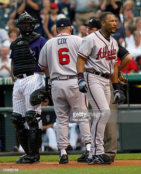 Atlanta Braves hitter Gary Sheffield walks away from home plate after he was ejected by home plate umpire Matt Hollowell in the first inning of the...