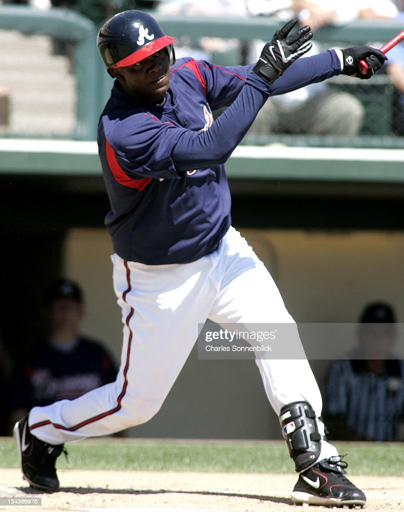 Atlanta Braves infielder Edgar Renteria (11) connects for a hit in a spring training game against the Los Angeles Dodgers Wednesday March 15, 2006 at Wide World of Sports in Orlando, Florida.