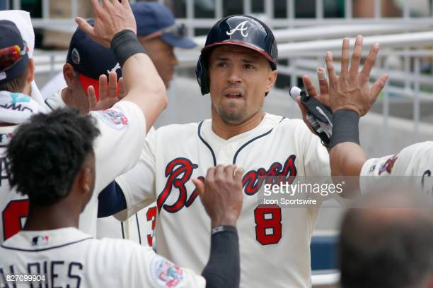 Atlanta Braves infielder Jace Peterson gets congratulations from his teammates after scoring the only run for the Braves during the MLB game between...