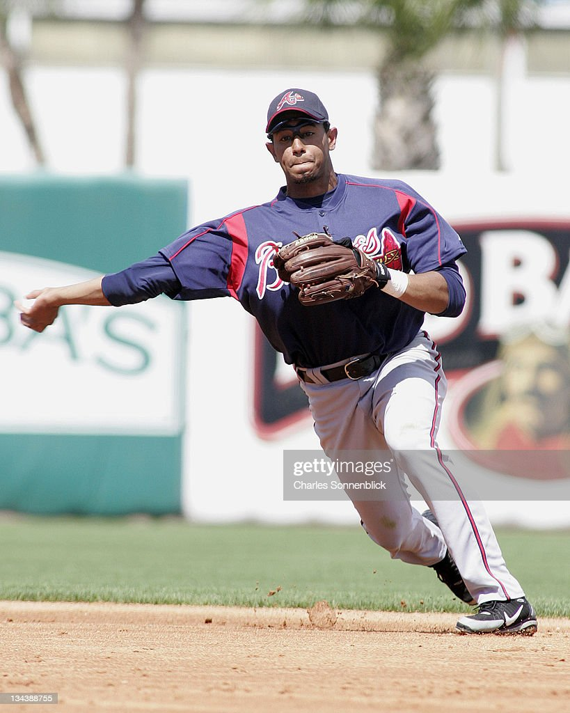 Atlanta Braves infielder Tony Pena fields a ground ball and throws to first for the out in a spring training game against the New York Yankees...