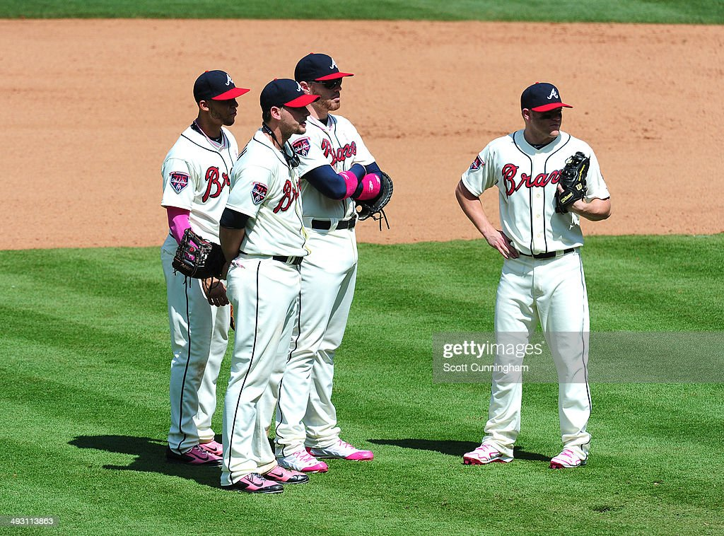 Atlanta Braves Infielders Andrelton Simmons Chris Johnson Freddie Freeman and Tyler Pastornicky wait during a pitching change against the Chicago...