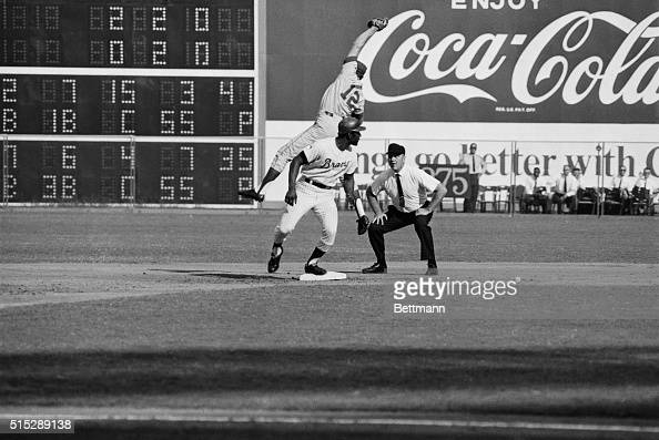 Atlanta Braves leftfielder Rico Carty is easily safe at second on a double into the left field corner in the second inning as the throw to New York...