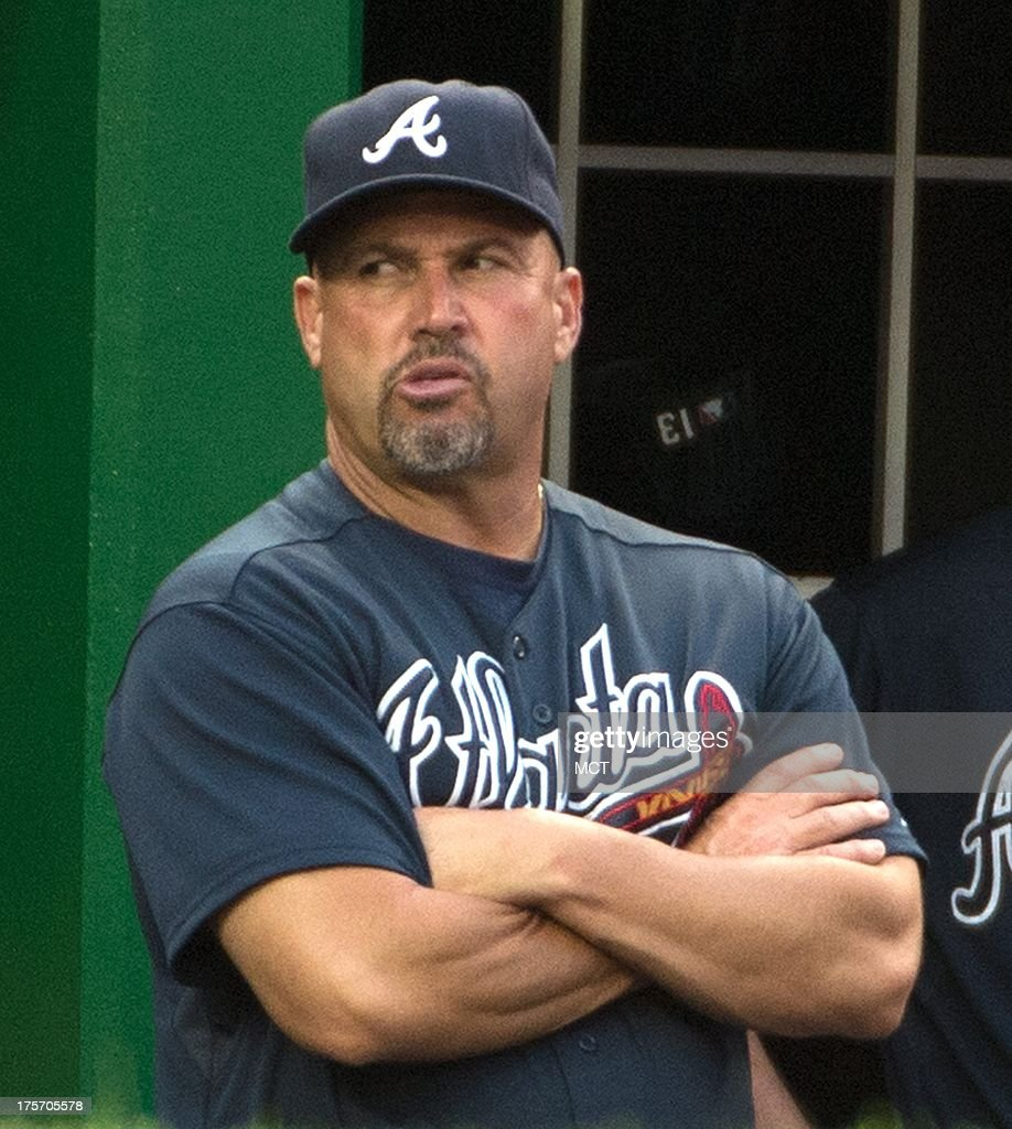 Atlanta Braves manager Fredi Gonzalez (33) watches from the dugout during the third inning of their game against the Washington Nationals at Nationals Park in Washington, D.C, Tuesday, August 6, 2013.