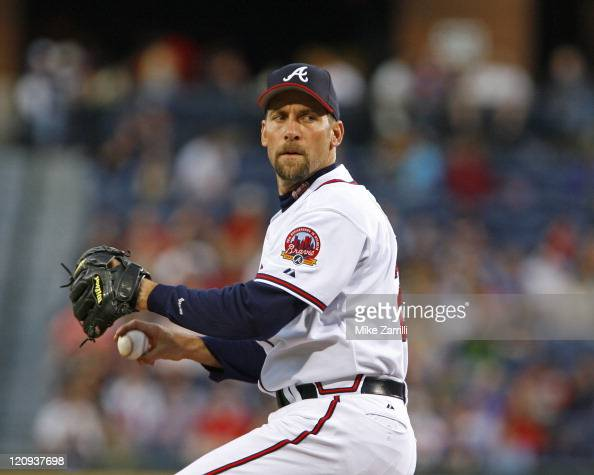 Atlanta Braves pitcher John Smoltz delivers a pitch during the game against the Washington Nationals at Turner Field in Atlanta GA on May 12 2006 The...
