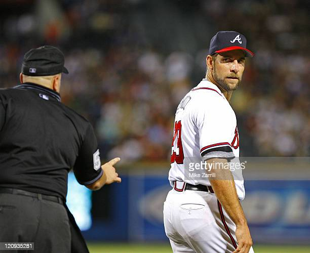 Atlanta Braves pitcher John Smoltz gets a warning from the umpire after arguing a call during the game between the Atlanta Braves and the Florida...