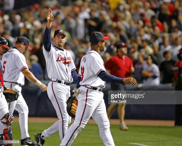 Atlanta Braves pitcher John Smoltz waves to the crowd after his complete game win against the Washington Nationals at Turner Field in Atlanta GA on...