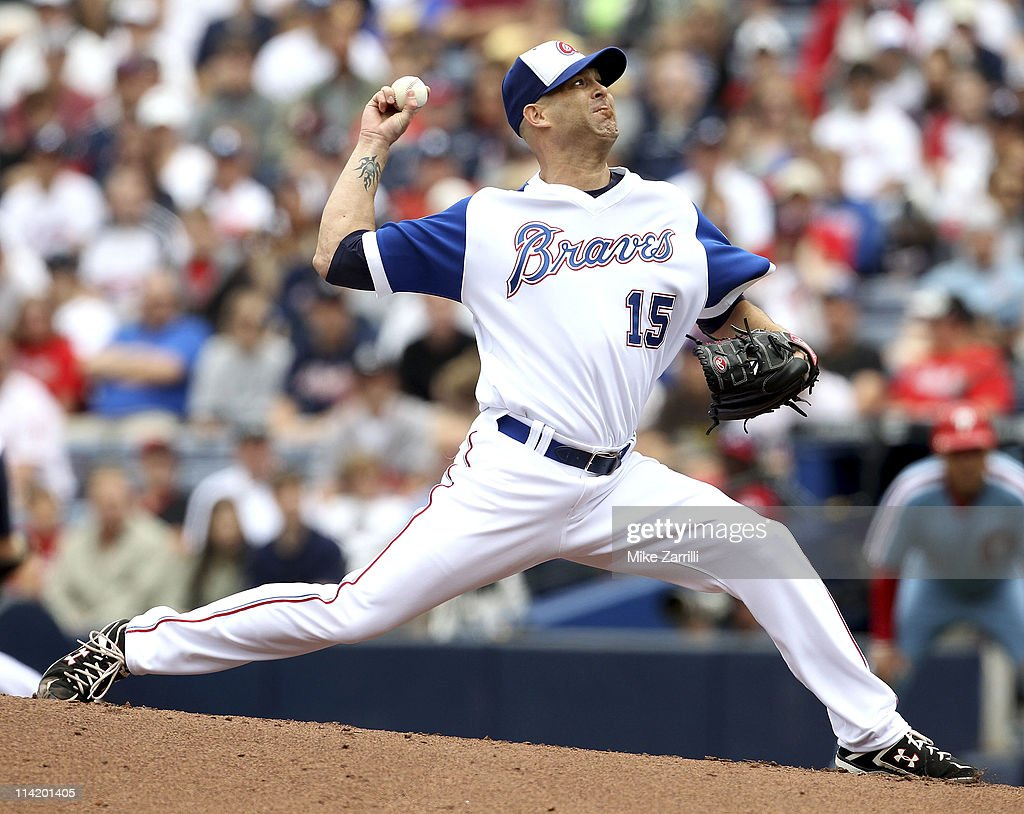 Atlanta Braves pitcher <a gi-track='captionPersonalityLinkClicked' href=/galleries/search?phrase=Tim+Hudson&family=editorial&specificpeople=203108 ng-click='$event.stopPropagation()'>Tim Hudson</a> #15 throws a pitch during the MLB Civil Rights Game between the Philadelphia Phillies and the Atlanta Braves on Sunday, May 15, 2011 at Turner Field in Atlanta, Georgia.
