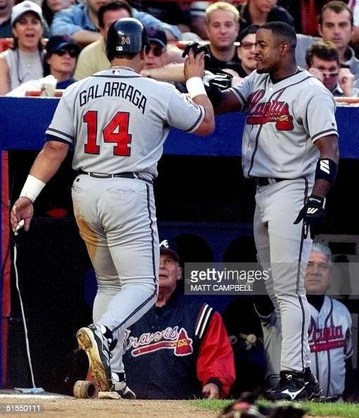 Atlanta Braves right fielder Brian Jordan congratulates first baseman Andres Gallaraga after Gallaraga scored from third on an error by New York Mets...