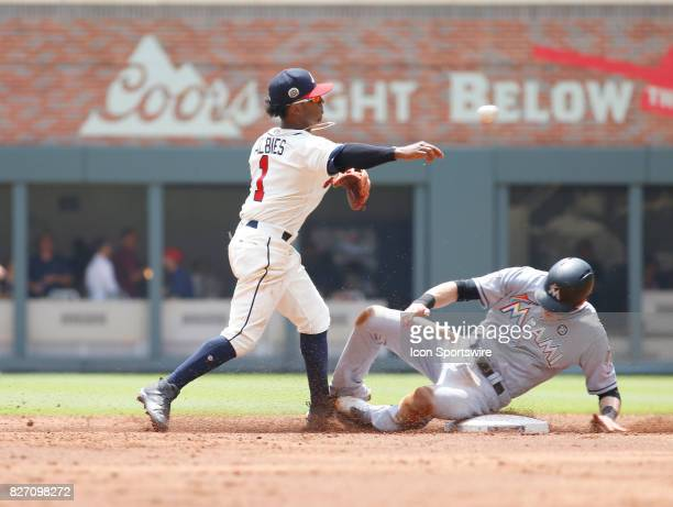 Atlanta Braves rookie infielder Ozzie Albies turns a double play during the MLB game between the Atlanta Braves and the Miami Marlins on August 6...