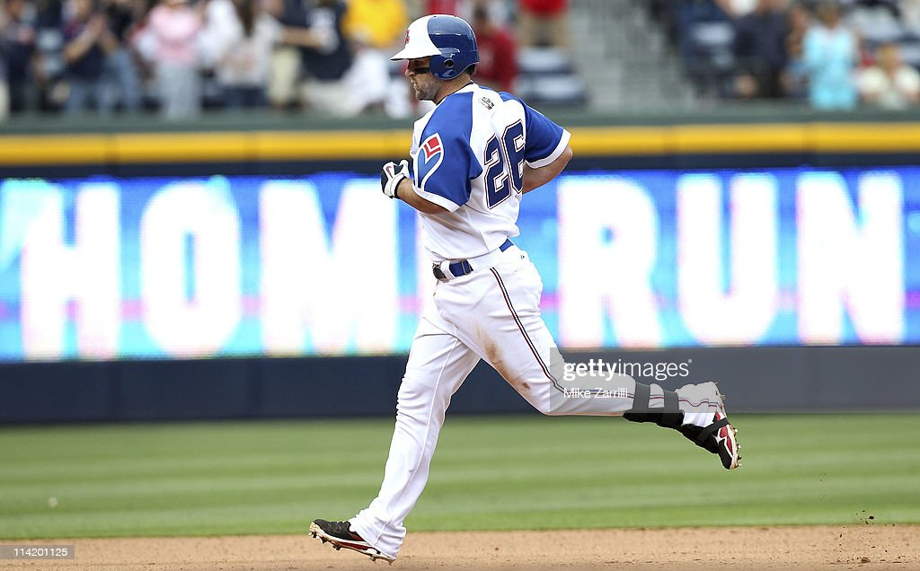 Atlanta Braves second baseman <a gi-track='captionPersonalityLinkClicked' href=/galleries/search?phrase=Dan+Uggla&family=editorial&specificpeople=542208 ng-click='$event.stopPropagation()'>Dan Uggla</a> #26 circles the bases after hitting what would be the game winning home run during the MLB Civil Rights Game against the Philadelphia Phillies on Sunday, May 15, 2011 at Turner Field in Atlanta, Georgia. The Braves beat the Phillies 3-2.