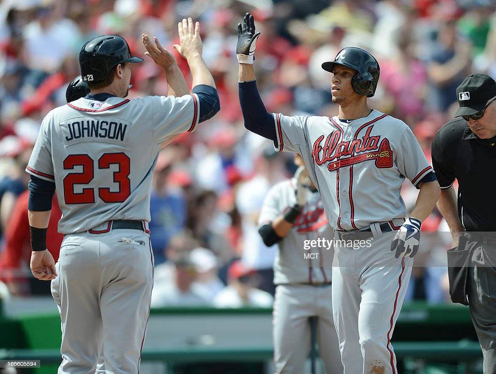 Atlanta Braves shortstop Andrelton Simmons right is greeted by teammates Chris Johnson and Dan Uggla back following hist threerun home run against...