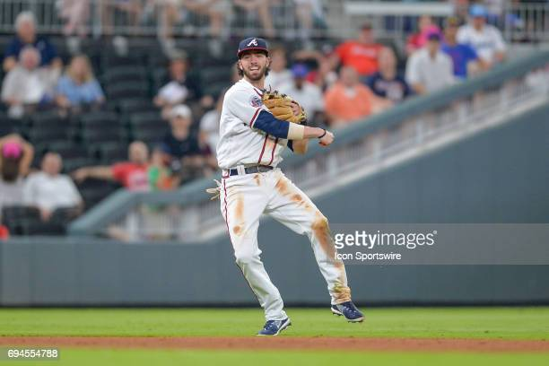 Atlanta Braves shortstop Dansby Swanson makes an offbalance throw to first base during a game between the Atlanta Braves and New York Mets on June 9...