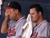 Atlanta Braves starting pitcher Greg Maddux sits on the bench with coach Leo Mazzone after giving up two runs in the fifth inning against the San...