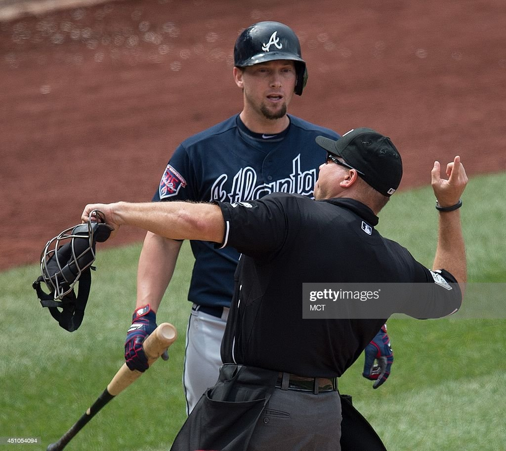 Atlanta Braves third baseman Chris Johnson is ejected from the game by home plate mpire Mark Carlson after arguing a third called strike by umpire...