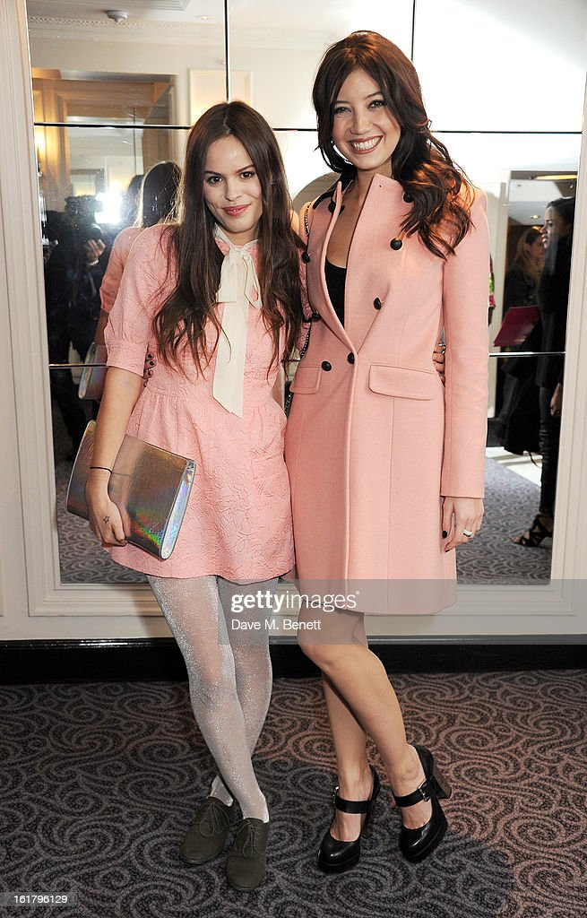 Atlanta de Cadenet (L) and Daisy Lowe attend the Moschino cheap&chic show during London Fashion Week Fall/Winter 2013/14 at The Savoy Hotel on February 16, 2013 in London, England.