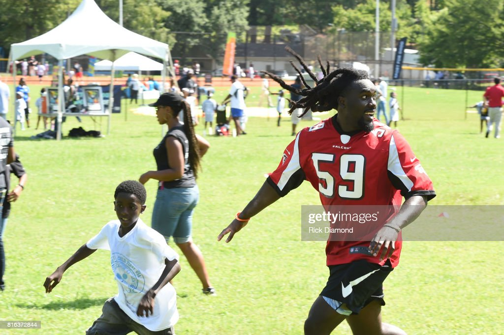Atlanta Falcon Linebacker De'Vondre Campbell and guest play at 'Nickelodeon's Worldwide Day Of Play And Laureus Sport For Good In Atlanta' at Washington Park on July 17, 2017 in Atlanta, Georgia.