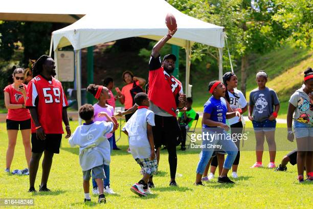Atlanta Falcon Linebacker De'Vondre Campbell and LaRoy Reynolds play football with kids during the Laureus Sport for Good Atlanta Launch on July 17...