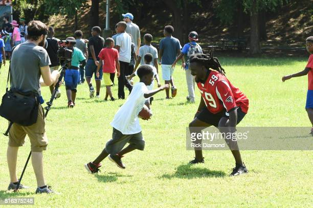 Atlanta Falcon Linebacker De'Vondre Campbell plays with a guest at 'Nickelodeon's Worldwide Day Of Play And Laureus Sport For Good In Atlanta' at...