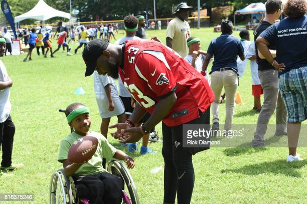 Atlanta Falcon Linebacker LaRoy Reynolds and guest play at 'Nickelodeon's Worldwide Day Of Play And Laureus Sport For Good In Atlanta' at Washington...