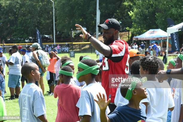 Atlanta Falcon Linebacker LaRoy Reynolds speak with guest at 'Nickelodeon's Worldwide Day Of Play And Laureus Sport For Good In Atlanta' at...