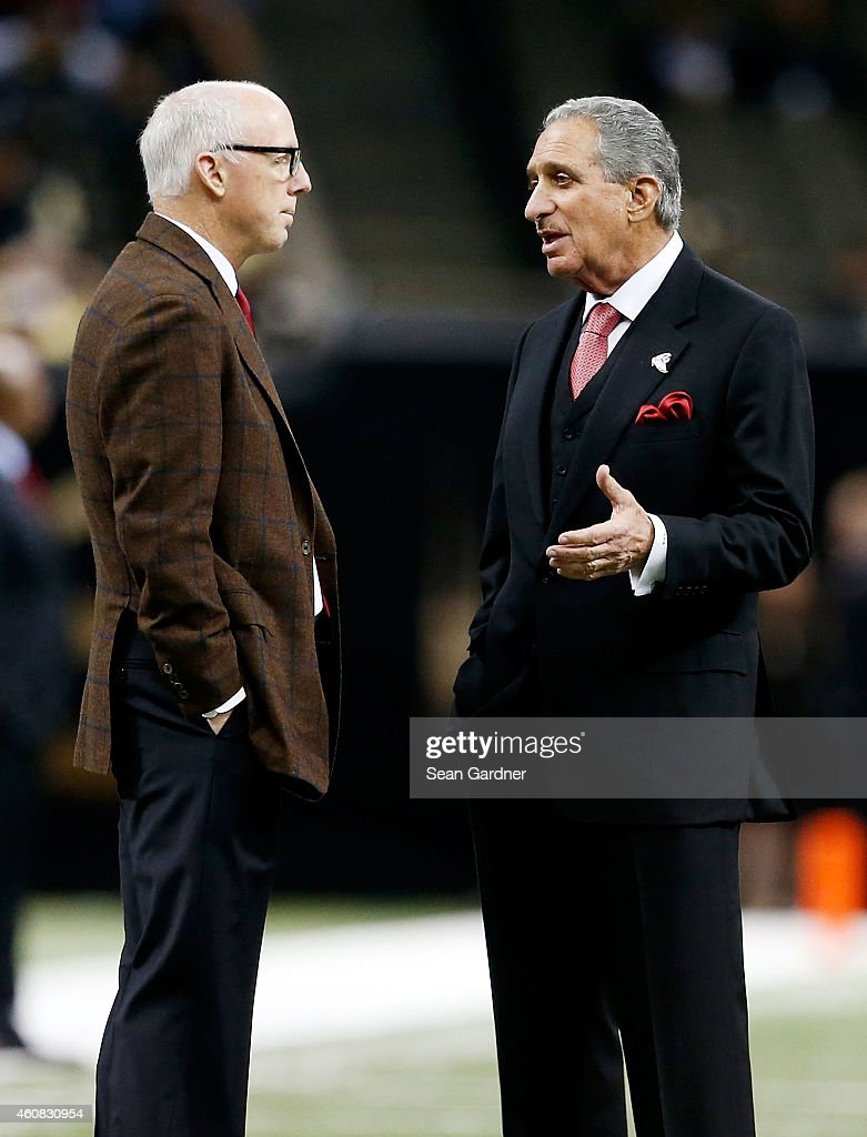 Atlanta Falcon President Rich McKay talks with Owner Arthur Blank prior to a game against the New Orleans Saints at the MercedesBenz Superdome on...