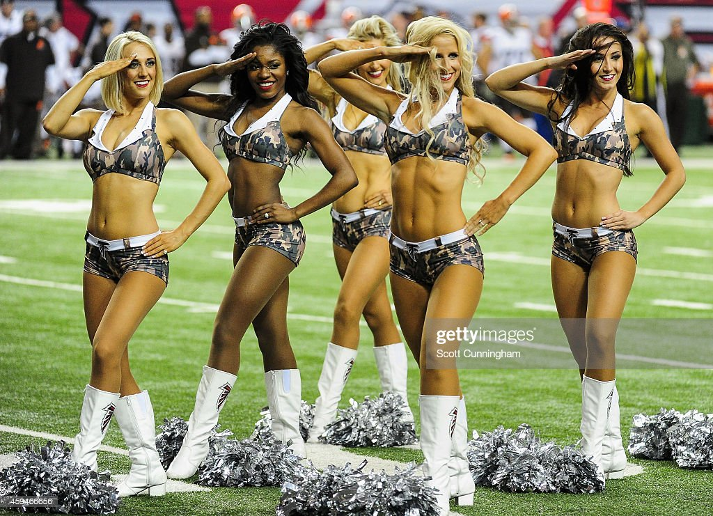 Atlanta Falcons cheerleaders perform in the second half against the Cleveland Browns at Georgia Dome on November 23 2014 in Atlanta Georgia The...