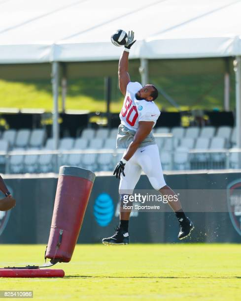 Atlanta Falcons defensive end Derrick Shelby takes part of a drill on August 01 2017 during the Atlanta Falcons Training Camp in Flowery Branch Ga