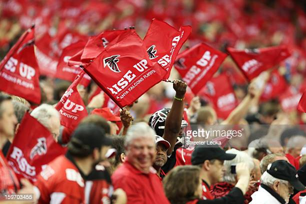 Atlanta Falcons fans wave flags during the NFC Divisional Playoff Game against the Seattle Seahawks at Georgia Dome on January 13 2013 in Atlanta...