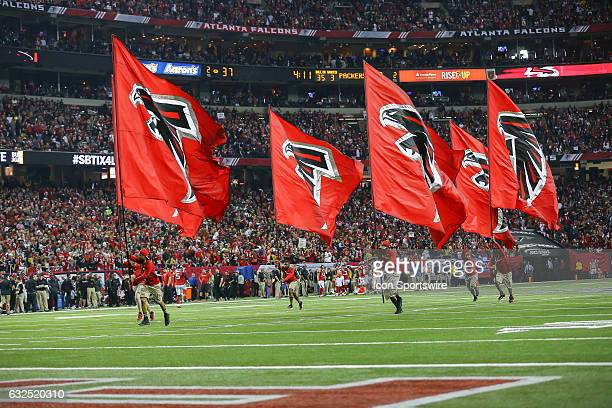 Atlanta Falcons flag crew runs on the field after scoring a touchdown during the second half of the NFC Championship Game game between the Green Bay...