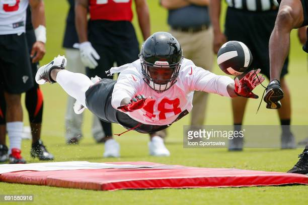 Atlanta Falcons Jordan Moore takes part in a drill during a football practice in Flowery Branch Ga
