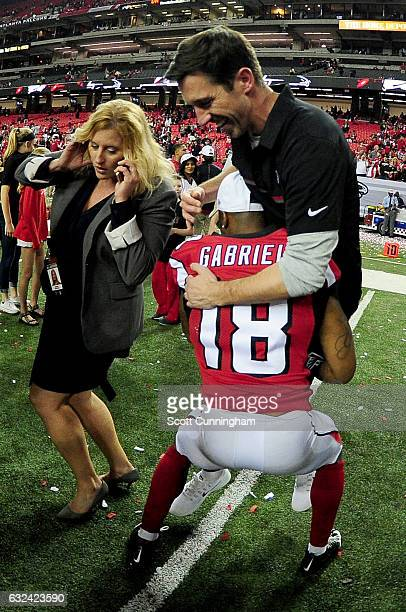 Atlanta Falcons offensive coordinator Kyle Shanahan celebrates with Taylor Gabriel after defeating the Green Bay Packers in the NFC Championship Game...