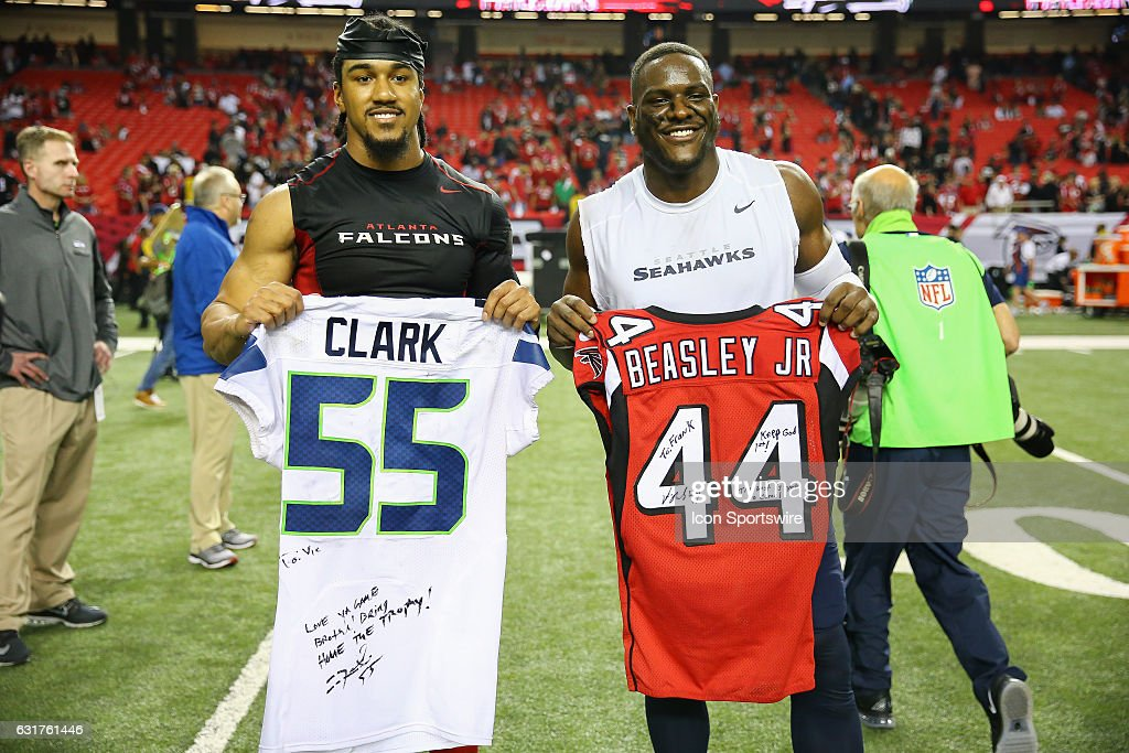Atlanta Falcons outside linebacker Vic Beasley (44) and Seattle Seahawks defensive end Frank Clark (55) trade jerseys after the NFC Divisional Playoff game between the Seattle Seahawks and the Atlanta Falcons on January 14, 2017, at the Georgia Dome in Atlanta, Georgia. The Falcons beat the Seahawks 36-20.