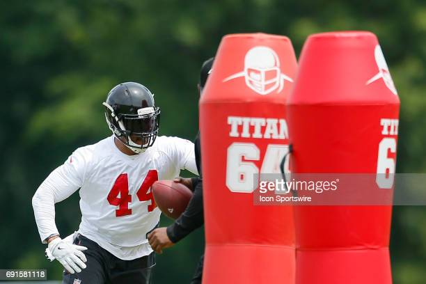 Atlanta Falcons outside linebacker Vic Beasley takes part in a drill during a football practice in Flowery Branch Ga
