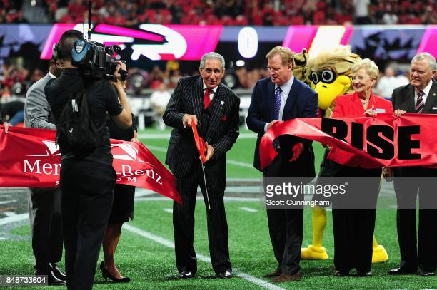 Atlanta Falcons owner Arthur Blank cuts a ribbon during a ceremony to introduce the new MercedesBenz Stadium as NFL Commissioner Roger Goodell looks...