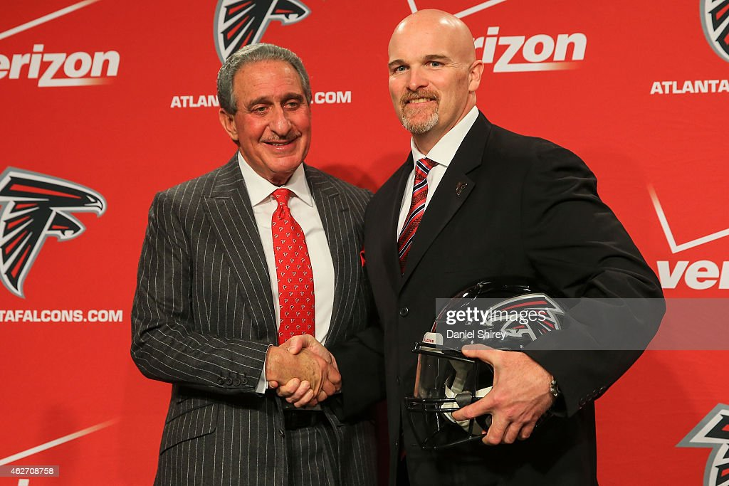 Atlanta Falcons owner Arthur Blank poses with new head coach Dan Quinn during a press conference at the Atlanta Falcons Training Facility on February...