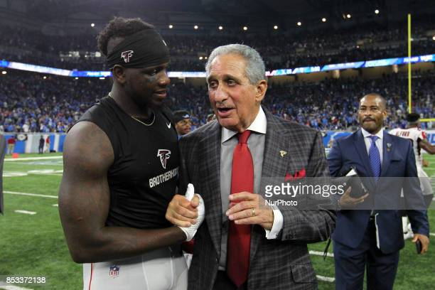 Atlanta Falcons owner Arthur Blank talks to wide receiver Mohamed Sanu after the 3026 victory over the Detroit Lions in Detroit Michigan USA on...