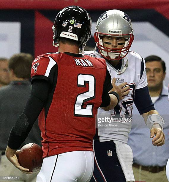 Atlanta Falcons quarterback Matt Ryan and New England Patriots quarterback Tom Brady exchange greeting before the start of tonight's game The New...