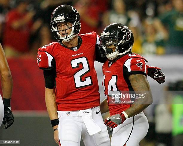 Atlanta Falcons quarterback Matt Ryan celebrates a touchdown with running back Devonta Freeman during an NFL football game between the Green Bay...